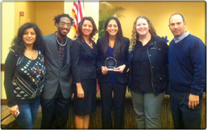 Nella Makdessi holds the Human Rights Youth Leadership Award presented to her by the Tampa/Hillsborough Human Rights Council.